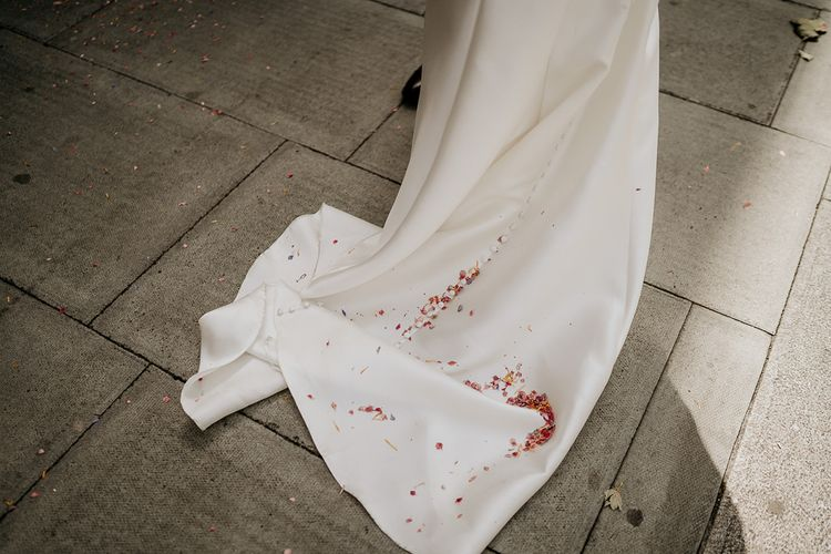 Confetti on the brides wedding dress train