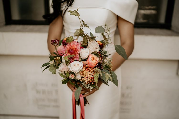 Bride holding her red and white bridal bouquet
