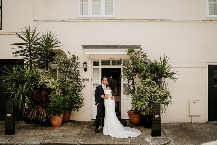 Bride and groom portrait by some plants