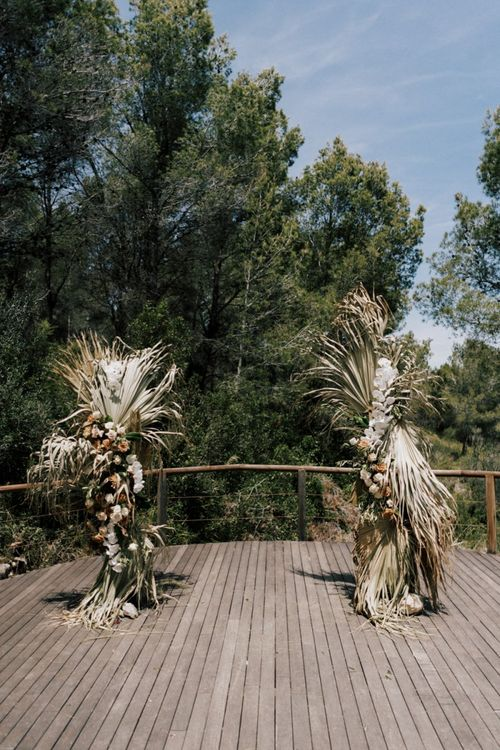 Nude Wedding Altar Wedding Flowers with Dried Palm Leaves, Roses and Orchids