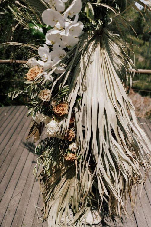 Dried Palm Leaves, Roses and Orchid Wedding Floral Arrangement
