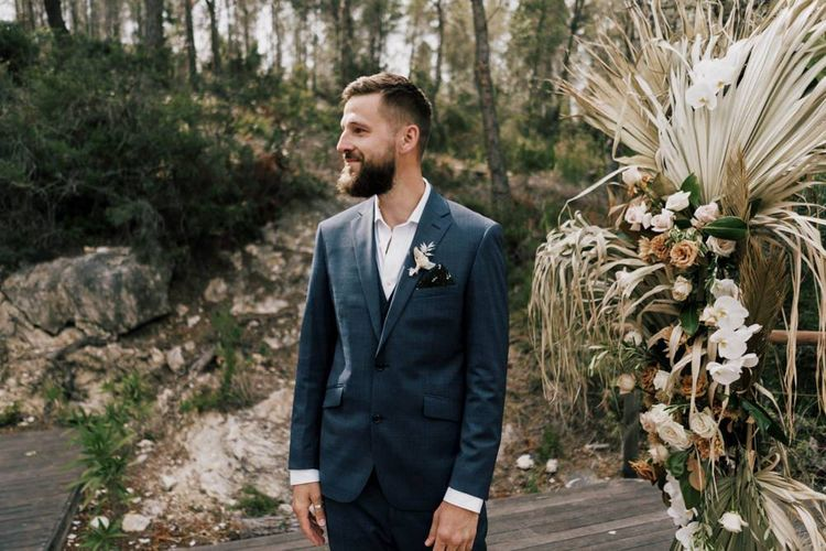 Groom at the Altar at the Outdoor Wedding Ceremony