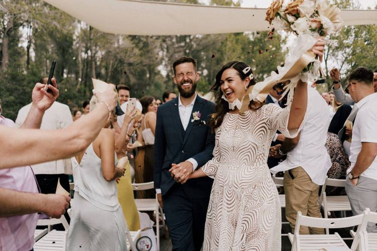 Bride in Margaux Tardits Wedding Dress  and Groom in a Navy Wedding Suit  Just Married