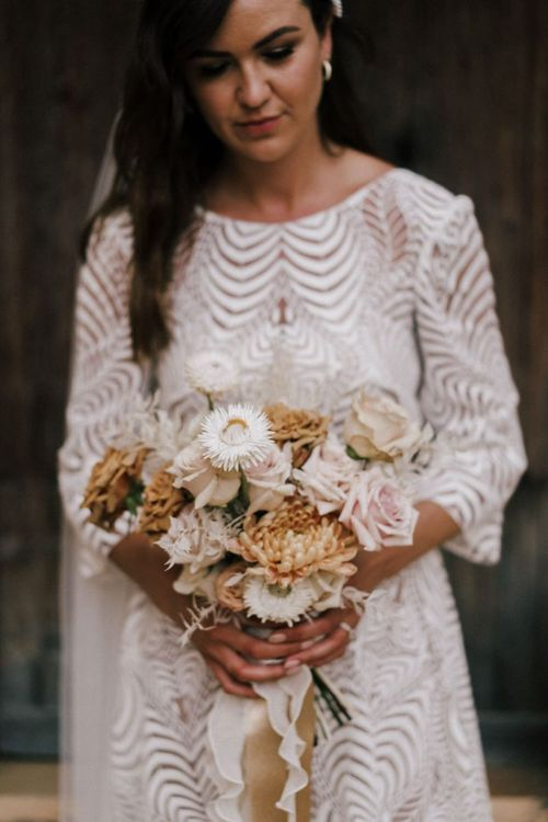 Bride in Margaux Tardits Wedding Dress Holding a Nude Rose and Dahlia Wedding Bouquet Tied with Ribbon