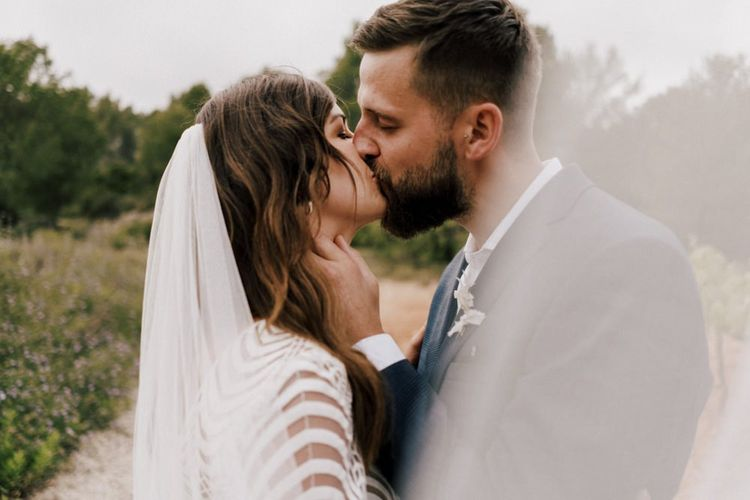 Intimate Bride and Groom Kissing Portrait