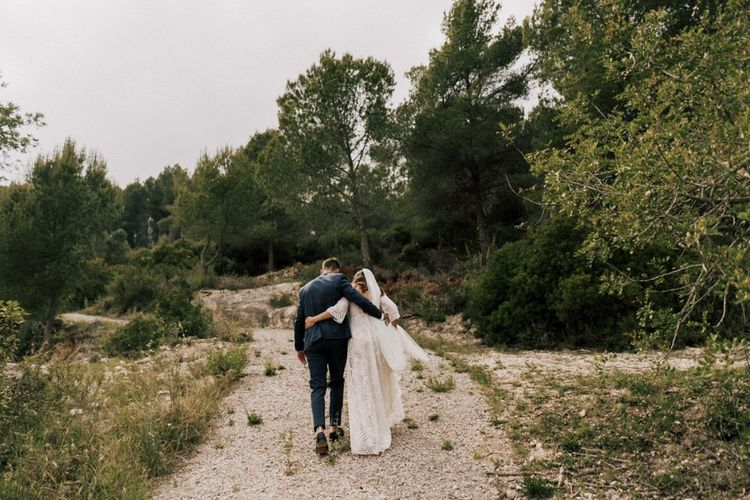 Stylish Bride and Groom Walking Down a Country Lane