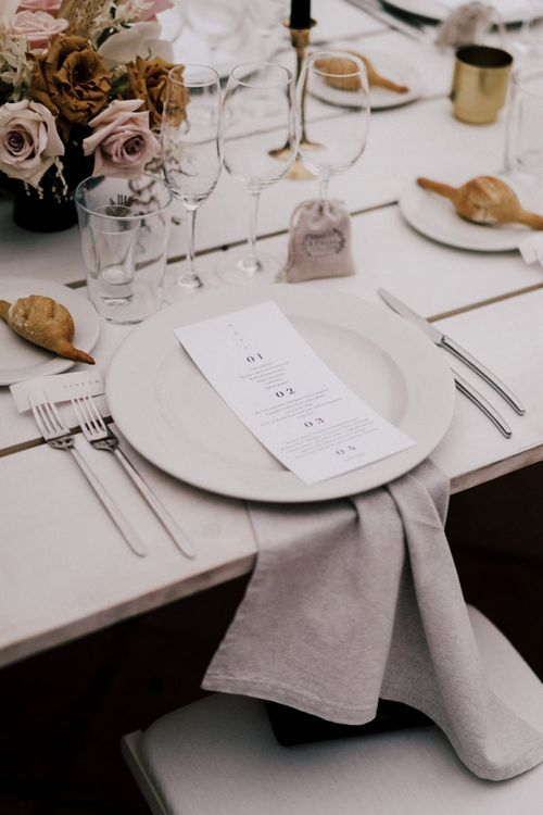 Minimalist Place Setting with Natural Linen Napkin and Menu Card