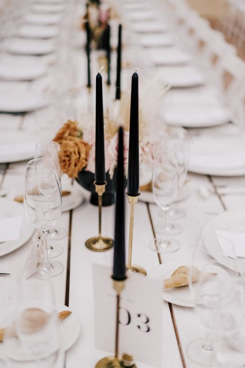 Gold Candlesticks and Black Taper Candles Wedding Decor
