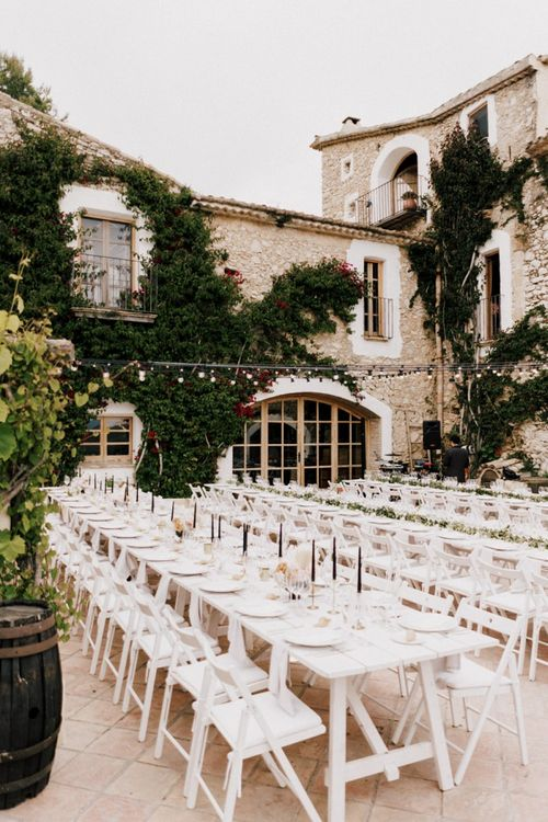 Outdoor Wedding Reception at Almiral de la Font in Barcelona with White Tables and Festoon Lights