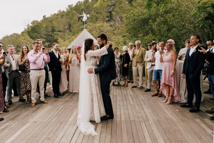 Bride in Margaux Tardits Wedding Dress and Groom in Navy Moss Bros. Suit Having Their First Dance