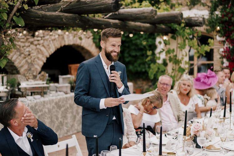 Bearded Groom in Navy Moss Bros. Suit Giving His Wedding Speech