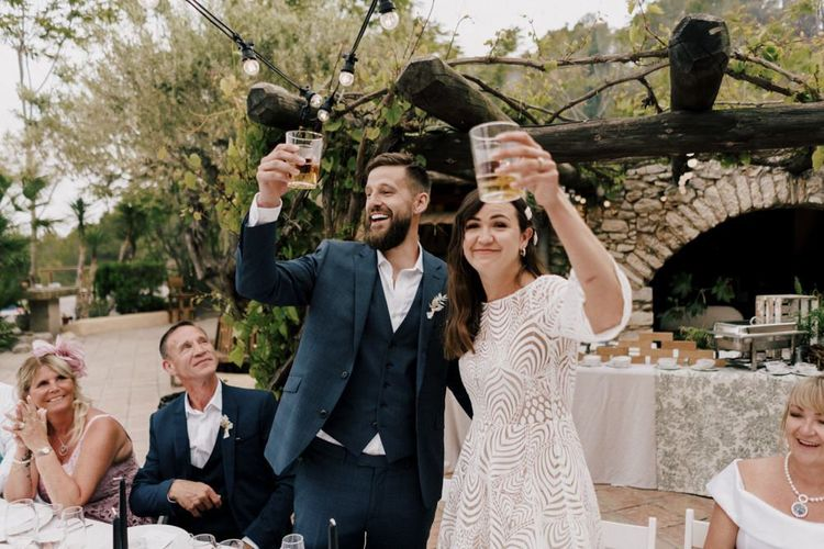 Bride and Groom Raising Their Glass at the Wedding Reception