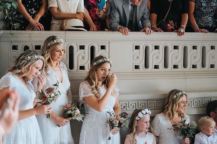 Bridesmaids in Different White Dresses and Flower Crowns Crying During the Wedding Ceremony