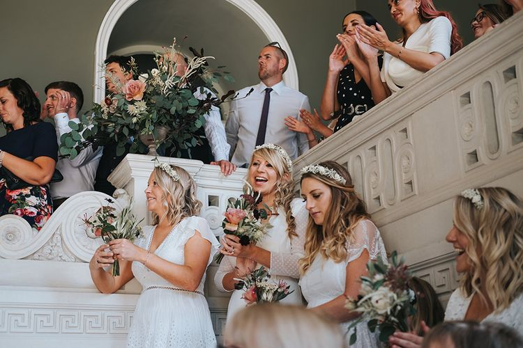 Bridesmaids and Wedding Guests Clapping and Cheering During The Wedding Ceremony at Pynes House, Devon