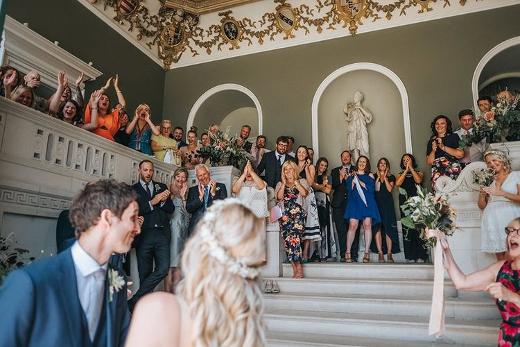 Wedding Guests Clapping and Cheering During The Wedding Ceremony at Pynes House, Devon