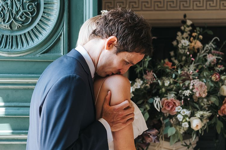 Groom Kissing His Brides Shoulder During The Wedding Ceremony