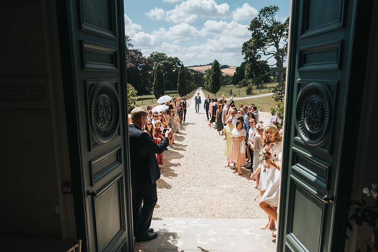 Wedding Guests Lining The Driveway of Pynes House, Devon Ready For The Bride and Groom Confetti Moment