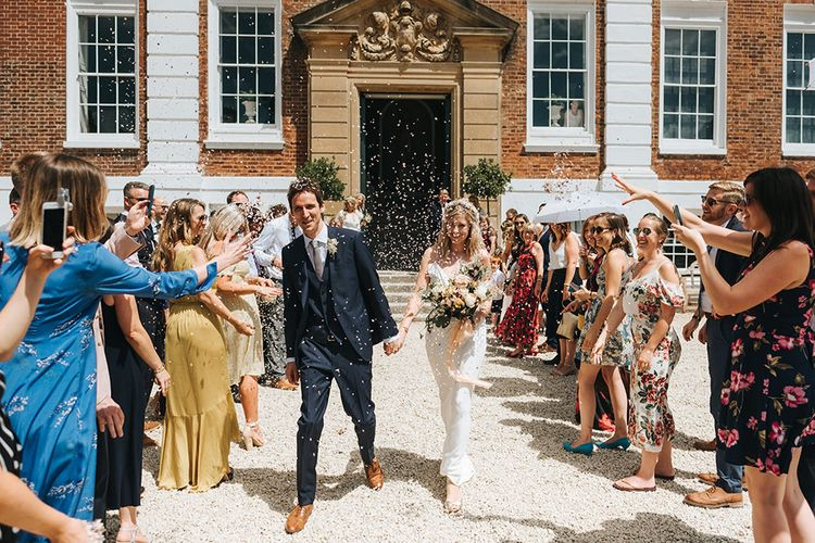 Confetti Moment with Bride in Savannah Miller Wedding Dress and Groom in Hugo Boss Suit
