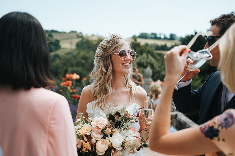 Boho Bride with Flower Crown and Sunglasses enjoying Talking to Her Wedding Guests