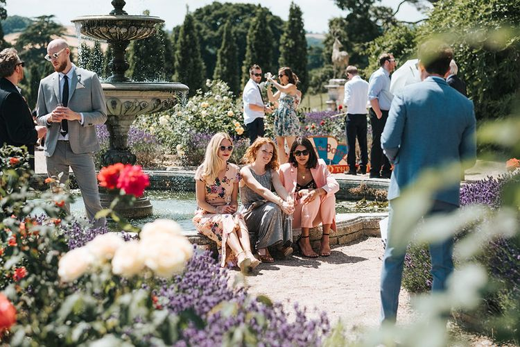 Wedding Guests Sitting in the Gardens of Pynes House, Devon