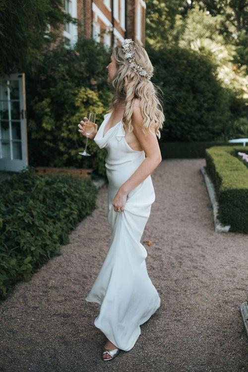 Boho Bride with Wavy Hair and Flower Crown in a Slinky Savannah Miller Chloe Wedding Dress