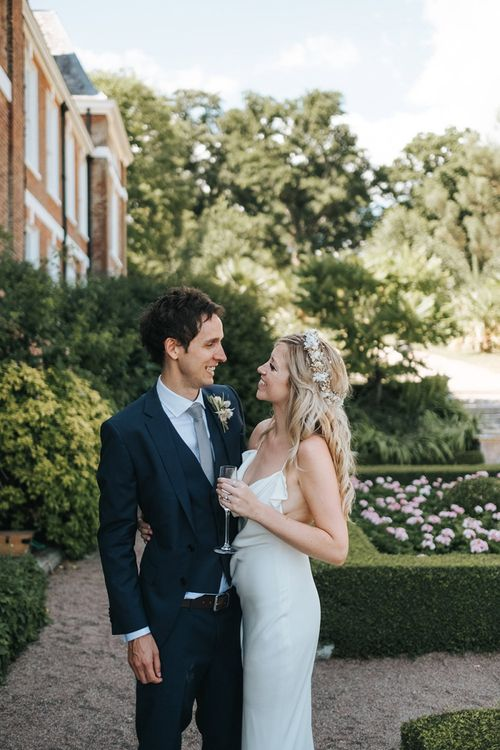 Bride and Groom Portrait with Bride in Minimalist Wedding Dress and Groom in Navy Suit
