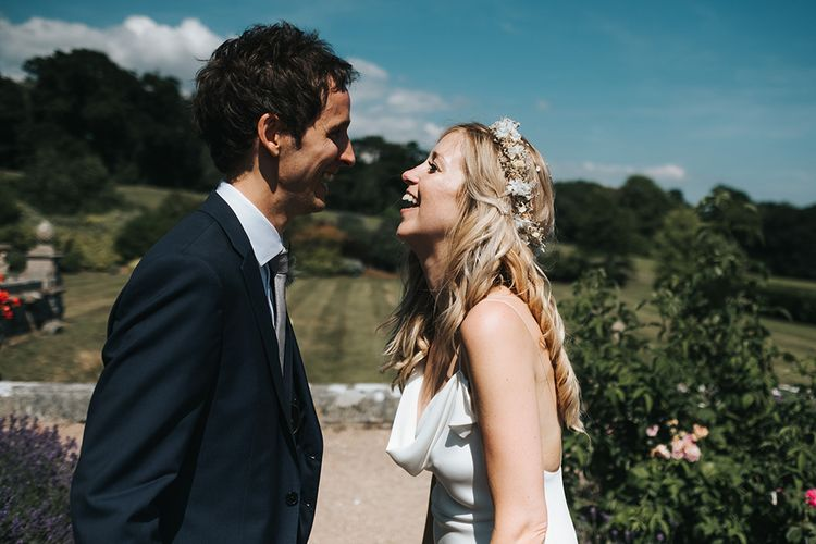 Bride and Groom Laughing Together with Bride in a Cowl Front Wedding Dress
