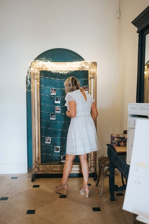 Bridesmaids Pinning Up Her Polaroid Picture on the Giant Frame Guest Book