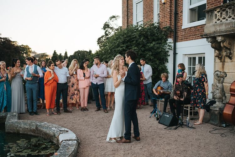 Bride and Groom Outdoor First Dance at Pynes House, Devon Surround By Their Wedding Guests