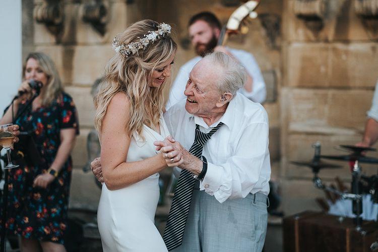 Boho Bride in Flower Crown and Slinky Wedding Dress Dancing With Her Grandad