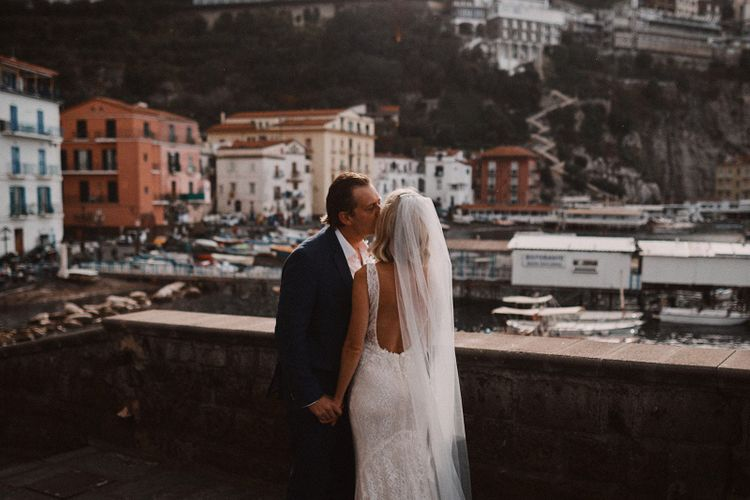 Intimate wedding portrait of bride and groom at the marina of Peters Beach Sorrento