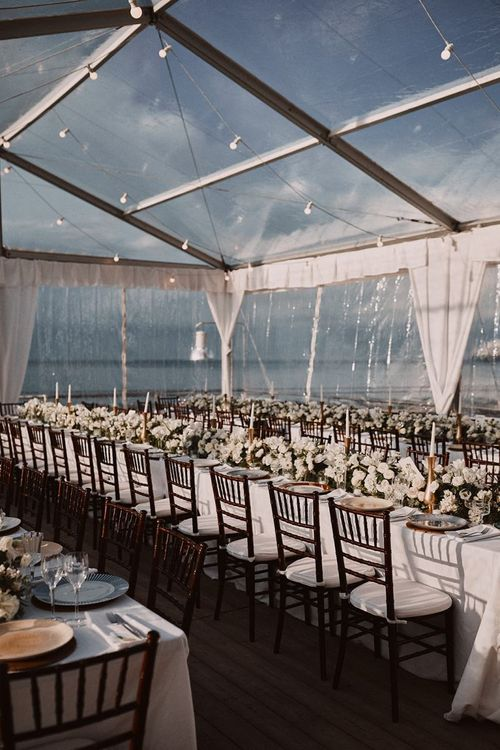 Clear span marquee with fairy lights and white flowers at Peters Beach Sorrento