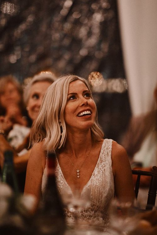 Bride with finger waves hair smiling during the wedding speeches