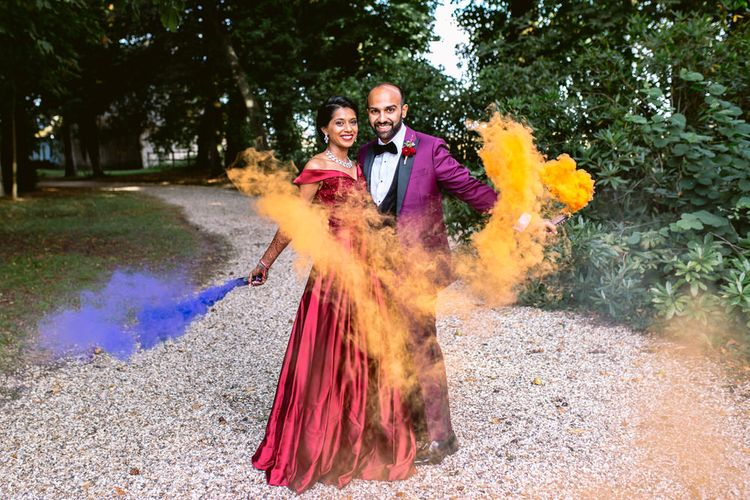 Colourful Smoke Bomb/Flares For Couples Shots At Wedding // Image By Aga Hosking