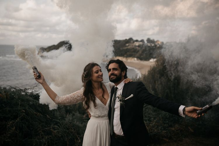 Colourful Smoke Bomb/Flares For Couples Shots At Wedding // Image By Coralie Monnet
