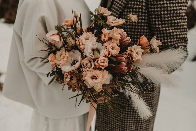 Peach wedding bouquet with king proteas and roses