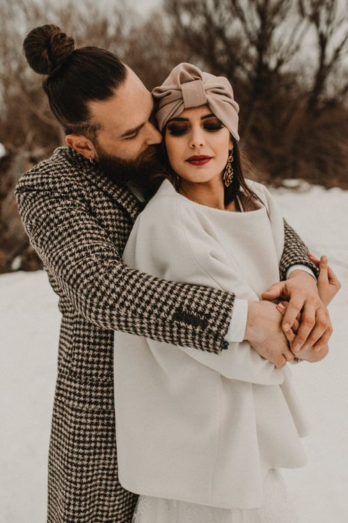 Stylish bride and groom embracing at Italian elopement