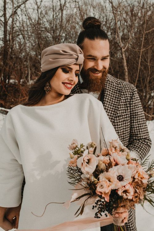 Stylish bride and groom at winter wedding