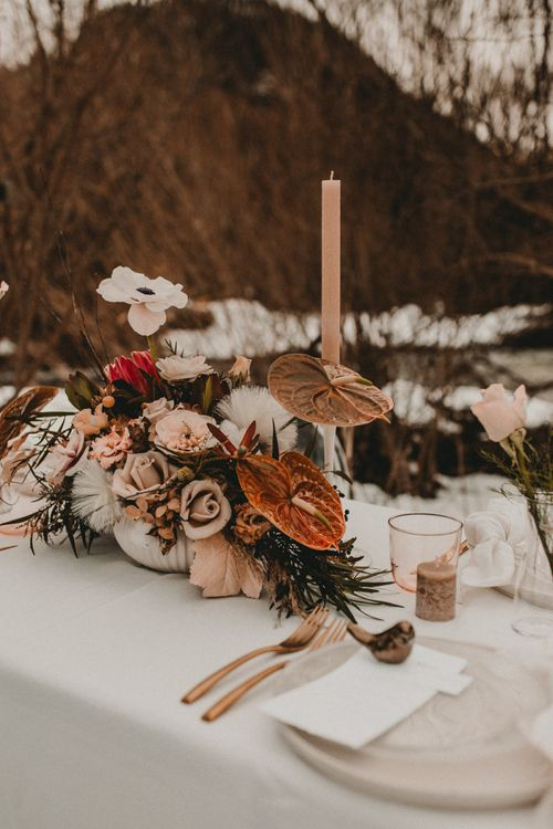 Flower centrepiece with anthuriums, and roses for snow wedding