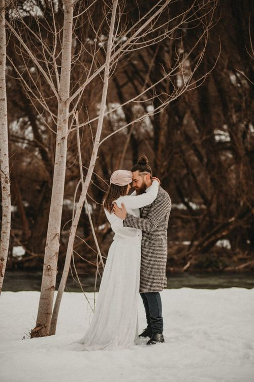 Winter wedding attire for snow wedding including jumper and coats