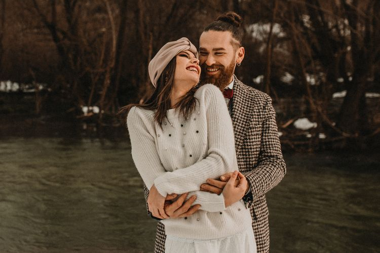 bride laughing in embellished woollen jumper and turban
