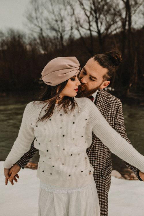 bride in stylish jumper and turban for snow wedding