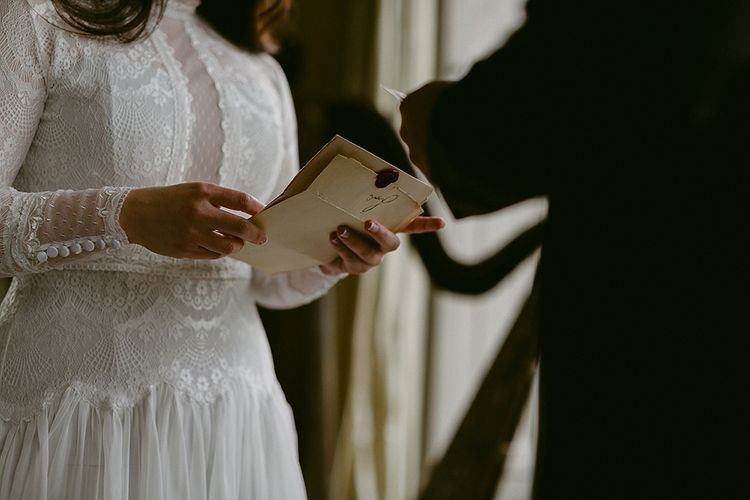 Bride in Homemade Wedding Dress with Lace Bodice and Long Sleeves Saying Her Vows