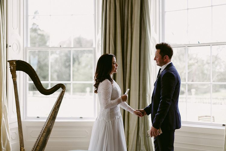 Bride and Groom Saying Their Wedding Vows Next to a Harp