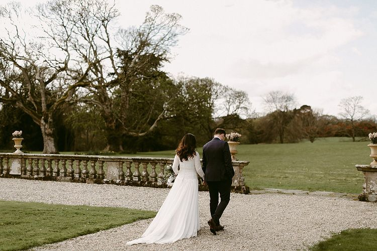 Bride in a Homemade Wedding Dress with Lace Bodice and Long Sleeves, and Groom in Navy Suit