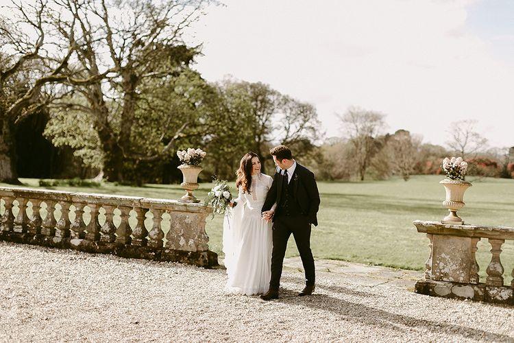 Bride in Homemade Wedding Dress with Long Sleeves and Groom in Zara Suit