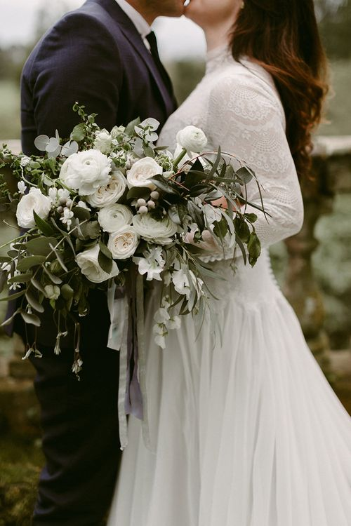 White Rose and Ranunculus Bridal Bouquet with Foliage