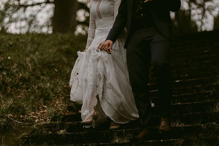 Bride in Homemade Wedding Dress with Lace Long Sleeves and High Neck