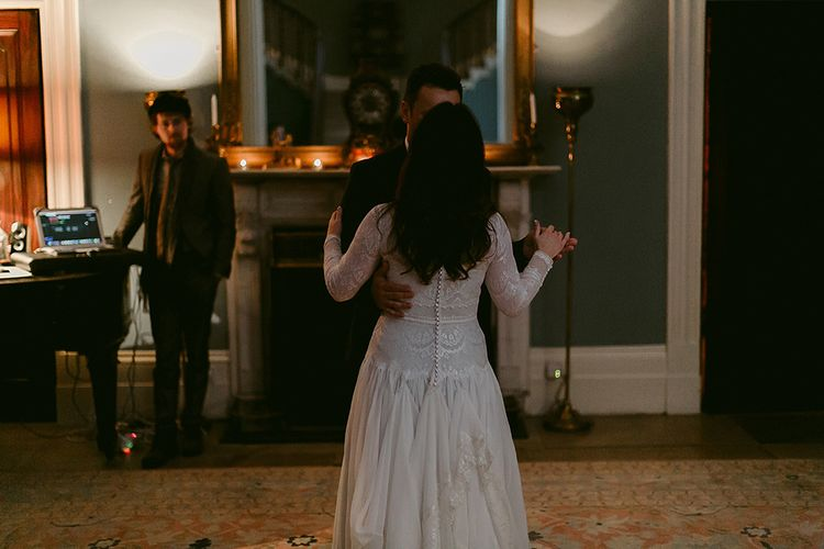 First Dance with Bride in Homemade Wedding Dress with Lace Long Sleeves and High Neck and Groom in Navy Zara Suit