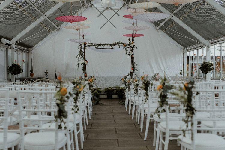 Aisle and Altar Style   Wedding Decor   Orange, White & Green Boho Wedding at Clifton Nurseries London    Olivia & Dan Photography
